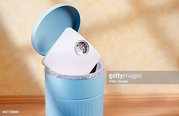 bathroom scales in bin - dieting stock pictures, royalty-free photos & images