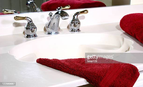 Bathroom sink and towels