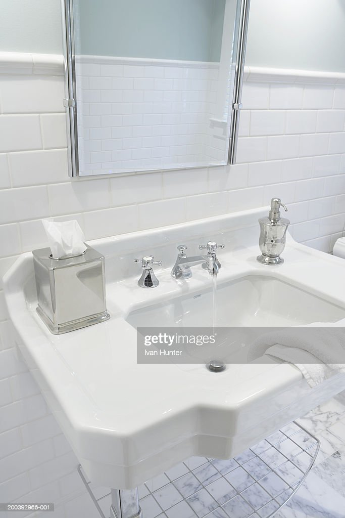 Bathroom Sink Faucet Running Stock Photo | Getty Images on cheap tub faucet, economical bathroom sink faucet, black bathroom sink faucet, cheap laundry faucet, old bathroom sink faucet, cheap toilets, cheap bathroom corner sink, cheap bathroom sink cabinets, cheap showers,