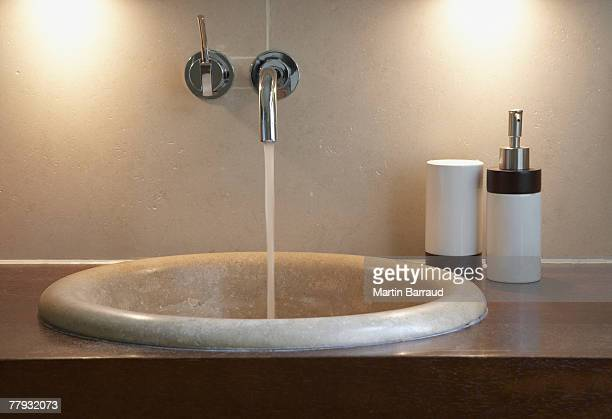 Bathroom sink with faucet on