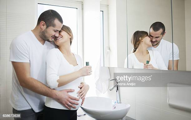 bathroom time - couple and kiss and bathroom stock photos and pictures