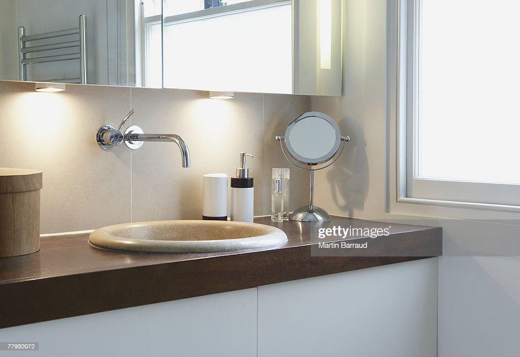Bathroom vanity beside window : Stock Photo