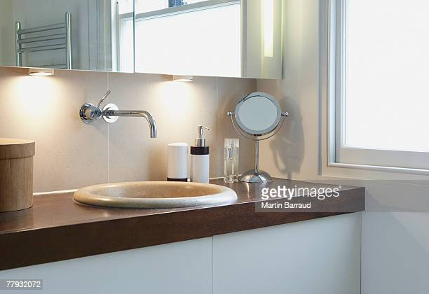Bathroom vanity beside window