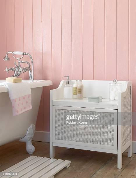 A Bathroom with a Rattan Side Cupboard