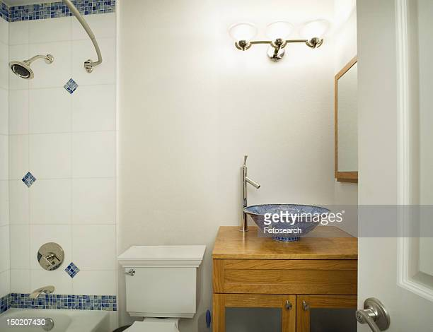 Bathroom with blue and white accents