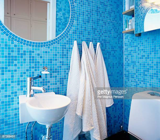 A bathroom with blue mosaic.