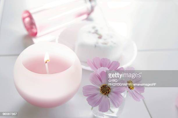 Bathroom with candle and flowers