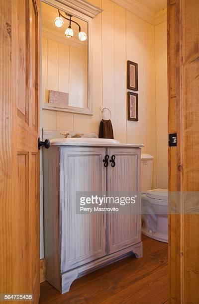 Bathroom with door open inside house