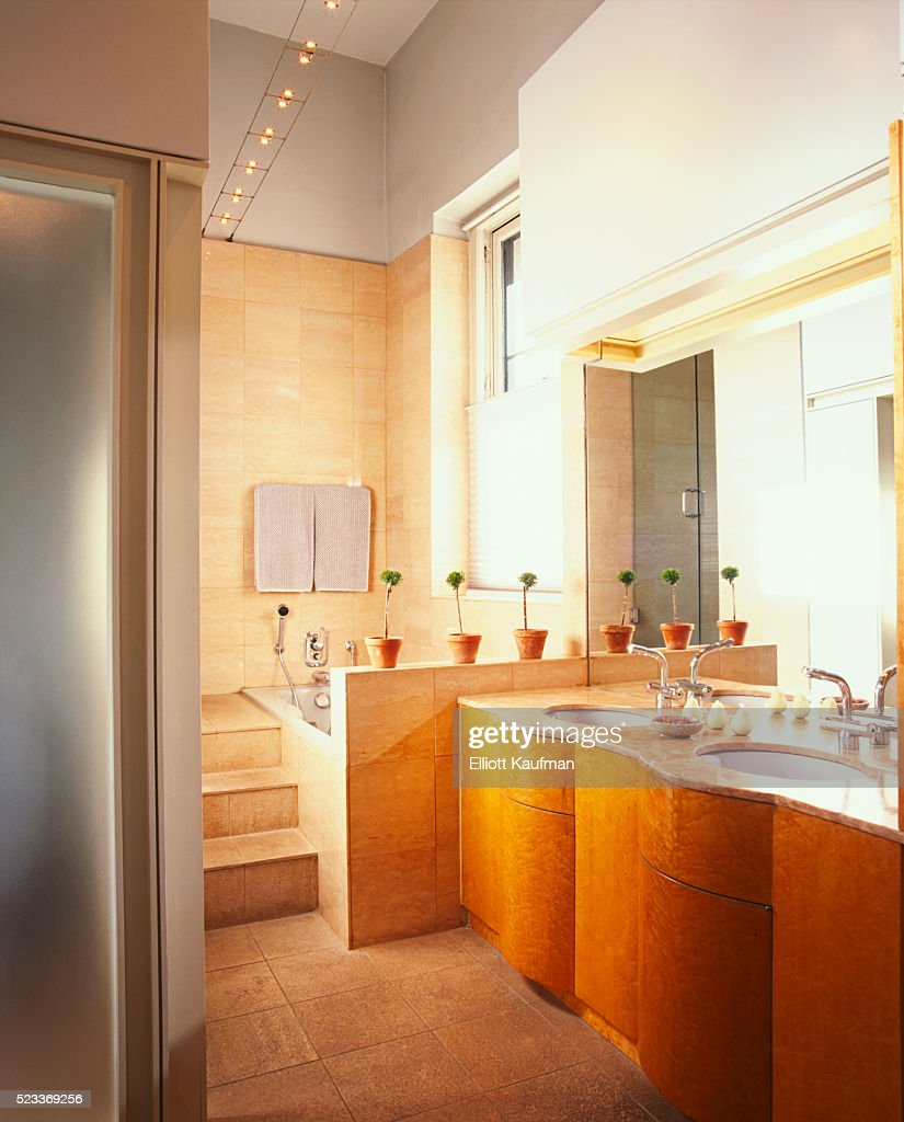 Bathroom With Marble Tile And Double Bow Front Bathroom Vanity Stock