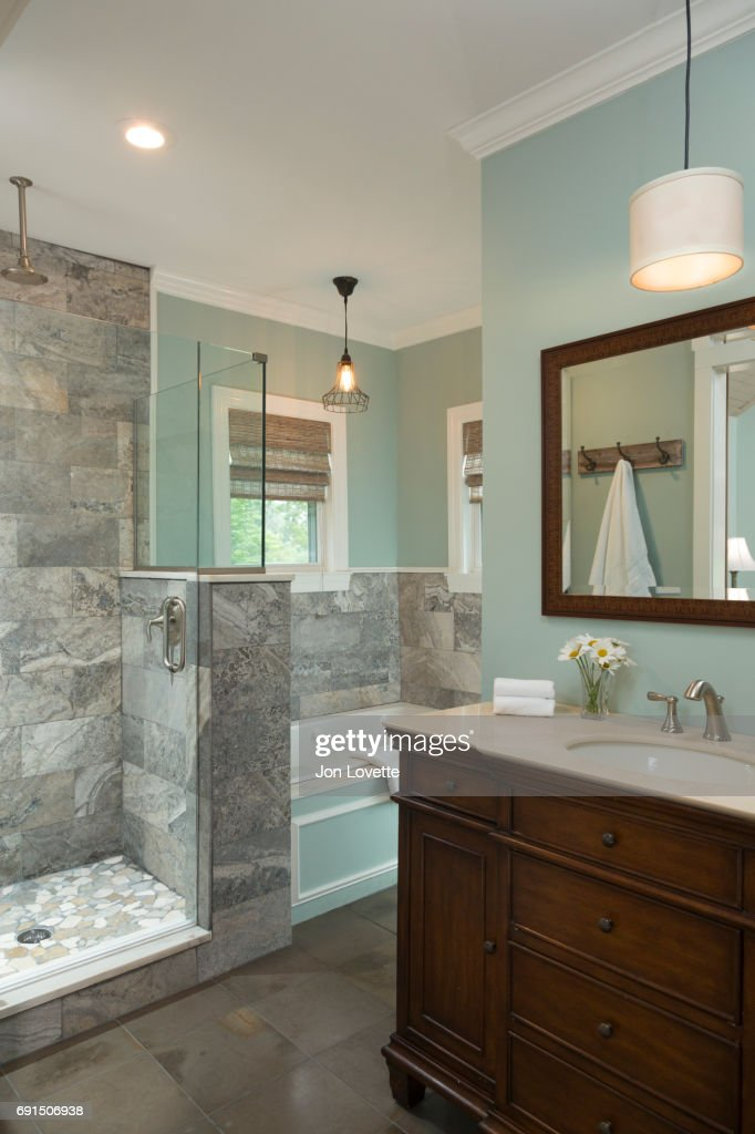 Bathroom With Pale Green Walls Shower And Bathtub Stock Photo
