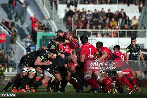 Bath's and Toulon's forwards vie in a scrum during the European Champions Cup rugby union match between RC Toulon and Bath on January 10 2016 at the...