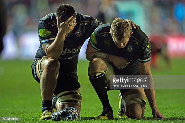 Bath's English lock Stuart Hooper and Bath's Australian flanker Leroy Houston react at the end of the European Rugby Champions Cup rugby union match...