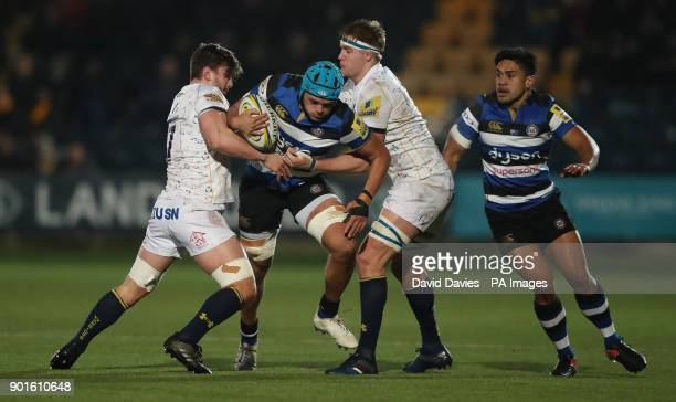 Bath's Zach Mercer is tackled by Worcester's Sam Lewis and GJ Van Velze during the Aviva Premiership match at Sixways Stadium Worcester