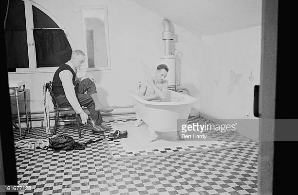Bathtime for tenants John Bailey and Cyril Chambers at the London Husbands' Hostel at 233 Charlton Road southeast London 1940 The hostel takes in men...