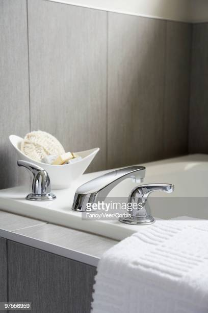 bathtub and faucet - loofah stock photos and pictures