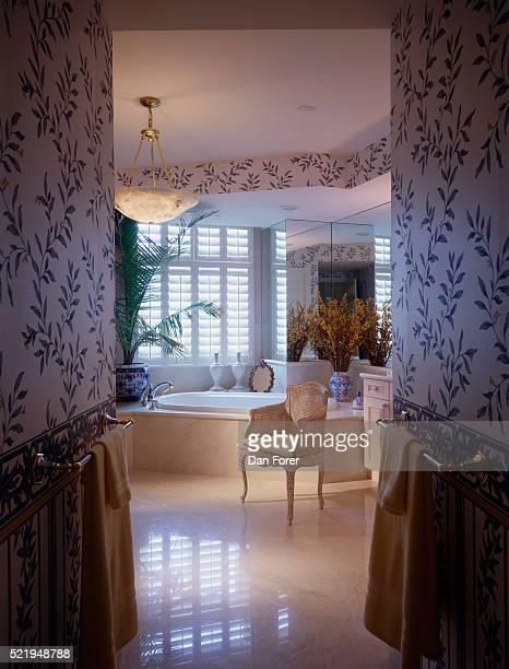 Bathtub by Window in Traditional Bathroom