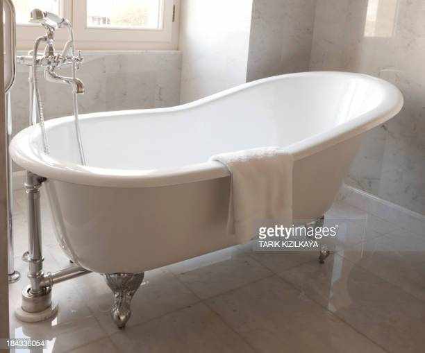 Bathtub in a luxurious hotel room.