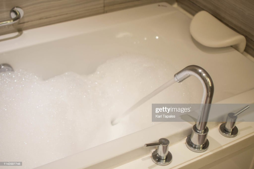 A bathtub with bubble bath : Stock Photo