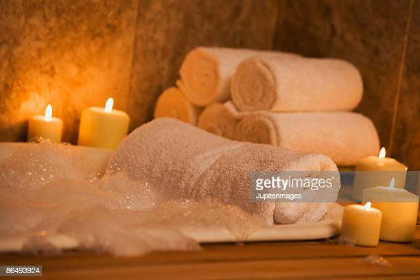 bathtub with candles and towels - bubble bath stock pictures, royalty-free photos & images