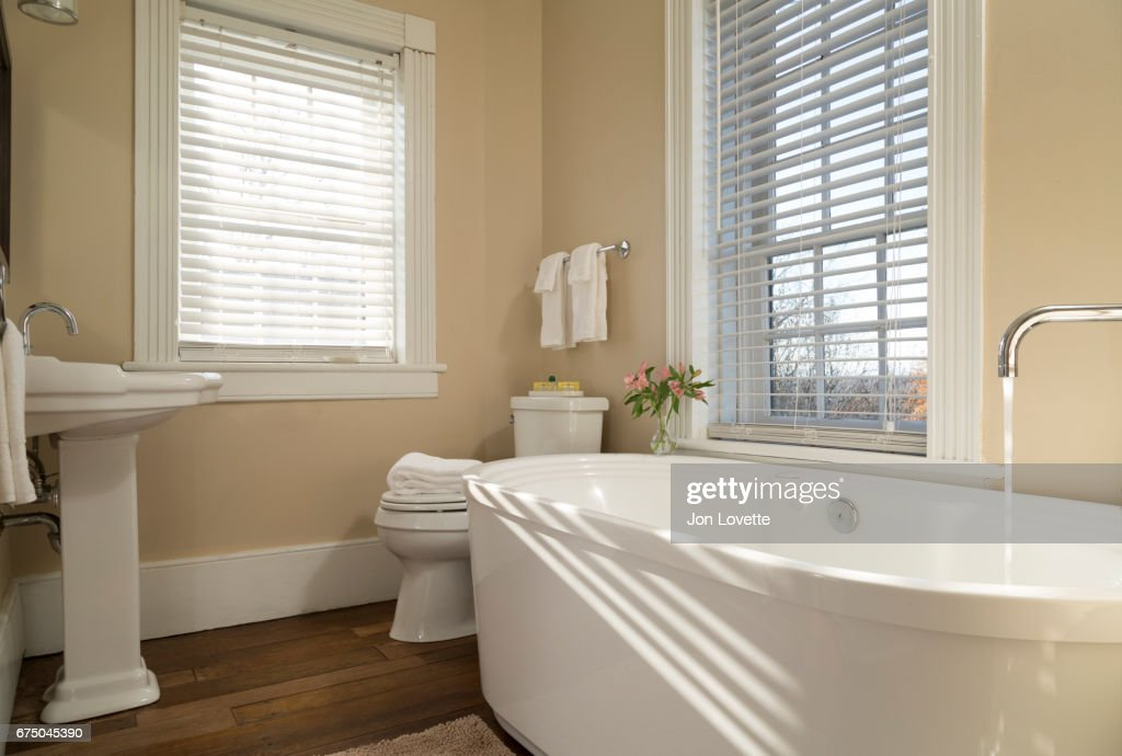 Bathtub With Water Running Stock Photo | Getty Images