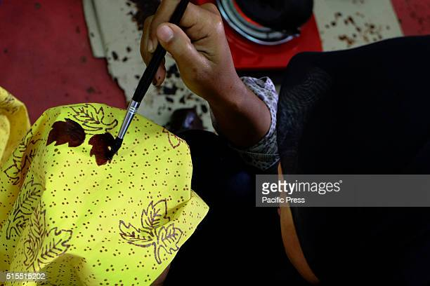 A batik craftsmen producing batik at batik production house in Pelalawan The level of creativity and the demands of the fashion market allows batik...