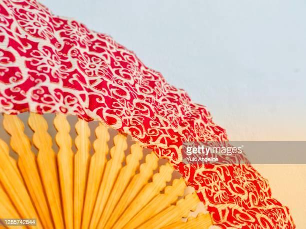 batik paper fan - batik stock pictures, royalty-free photos & images