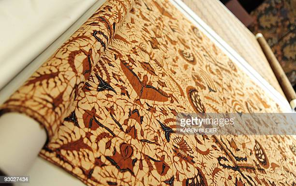 MONTET 'LIFESTYLEARTTEXTILEOBAMA' Batik patterned textiles collected by US President Barack Obama's mother Ann Dunham are displayed on August 5 2009...