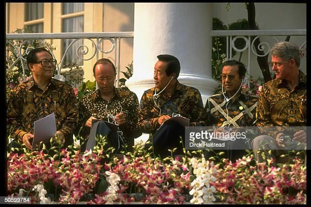 Batikshirted APEC ldrs Clinton Sultan alBokiah Kim Young Sam MacLeod Jiang Zemin during APEC economic summit