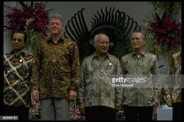 Batikshirted APEC ldrs Murayama Suharto Clinton Sultan al Bokiah during APEC economic summit