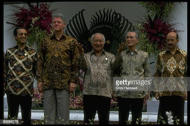 Batik-shirted APEC ldrs. Salinas de Gortari, Murayama, Suharto, Clinton & Sultan al Bokiah during APEC economic summit.