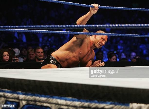 Batista climbs back into the ring against World Heavyweight Champion Edge during WWE Smackdown at Acer Arena on June 15 2008 in Sydney Australia