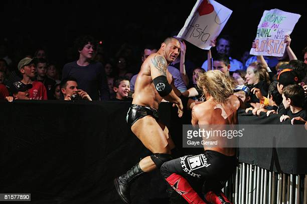 Batista fights World Heavyweight Champion Edge outside the ring during WWE Smackdown at Acer Arena on June 15 2008 in Sydney Australia