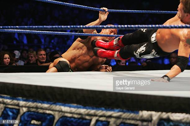 Batista is dropkicked as he tried to climb back into the ring against World Heavyweight Champion Edge during WWE Smackdown at Acer Arena on June 15...