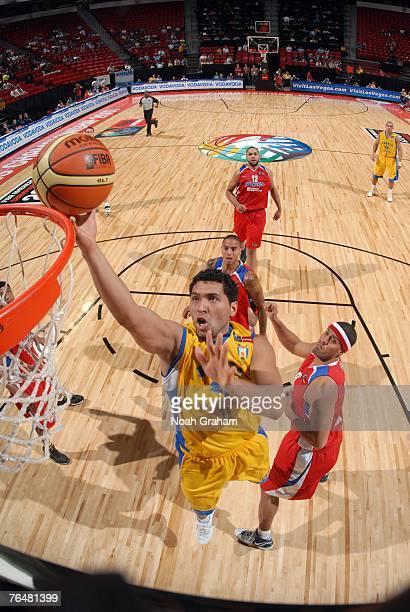 Batista of Brazil shoots against Richardo Sanchez of Puerto Rico during the bronze medal game of the 2007 FIBA Americas Championship at the Thomas...