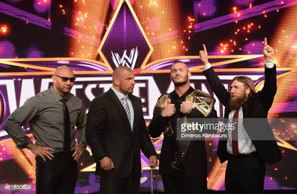 Batista, Triple H, Randy Orton and Daniel Bryan attend the WrestleMania 30 press conference at the Hard Rock Cafe New York on April 1, 2014 in New...