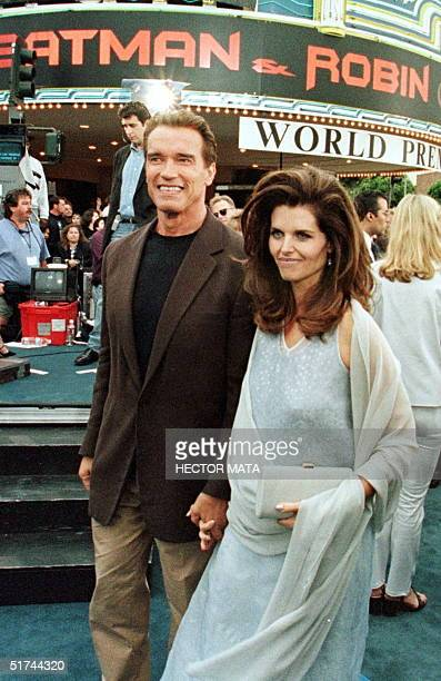 Batman and Robin actor Arnold Schwarzenegger arrives with his wife Maria Shriver at Mann's Village and Bruin Theater for the world premier of Batman...