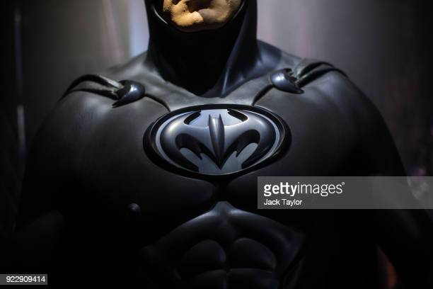 Batman costume from the 1997 Batman Robin film worn by George Clooney and designed by Rob Ringwood and Mary Vogt is on display at the DC Comics...