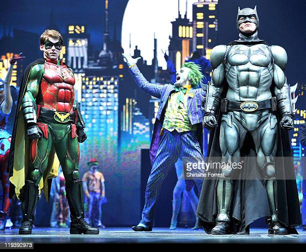 Batman played by Actor Sam Heughan Robin played by Actor Kamran DarabiFord and The Joker played by Actor Mark Frost perform on stage at the world...