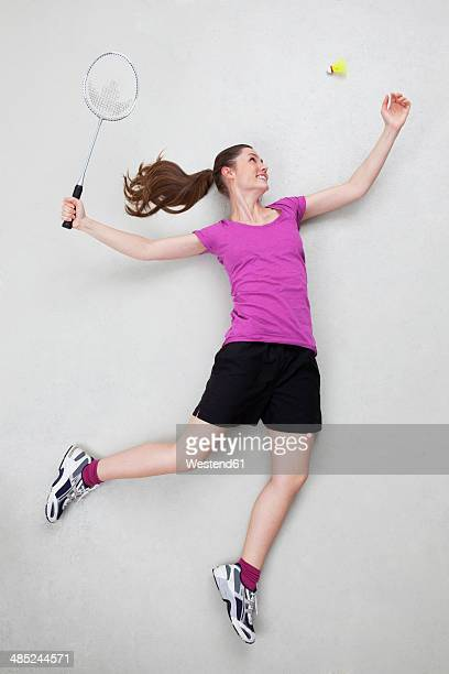 batminton player serving shuttlecock - badminton stock photos and pictures
