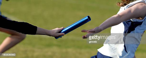 baton handoff - relay stock pictures, royalty-free photos & images