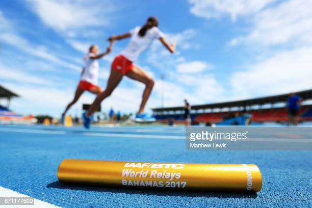 A baton is displayed in the foreground as athletes practice prior to the IAAF / BTC World Relays Bahamas 2017 at the Thomas Robinson Stadium on April...