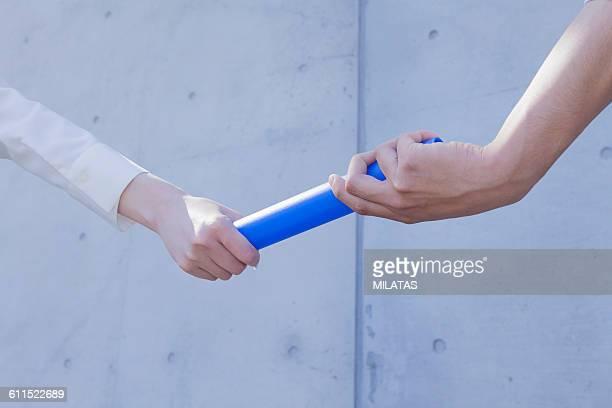 baton pass - バトン ストックフォトと画像