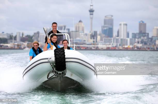 Baton relay manager Joanne Shaw New Zealand Commonwealth Games athletes Joelle King and Nikki Hamblin and with Chef de Mission Rob Waddell behind the...
