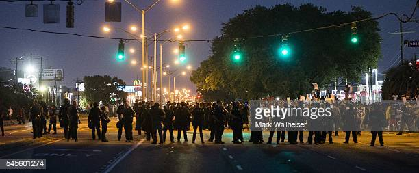 Baton Rouge police in riot gear block Airport Rd across from the police department to keep protesters back on July 8 2016 in Baton Rouge Louisiana...