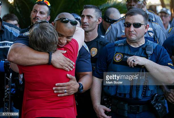 Baton Rouge Police Officers recieve hugs from wellwishers during a rally with nearly 400 motorcycle riders from various local clubs who rode to...