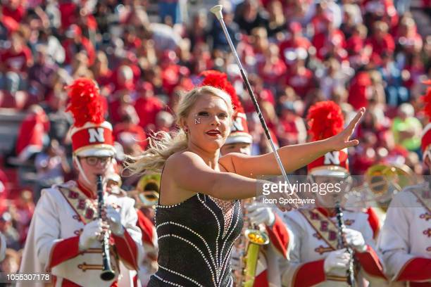 Baton twirler of the Corn Husker Marching Band performs at halftime during the game between the BethuneCookman Wildcats and the Nebraska Cornhuskers...