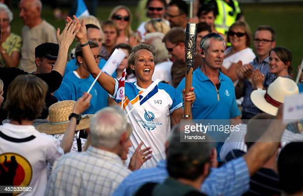 Batonbearer 142 Allison Curbishley carries the Glasgow 2014 Queen's Baton in Queen's Park on July 22 2014 in Glasgow Scotland Scotland is nation 70...