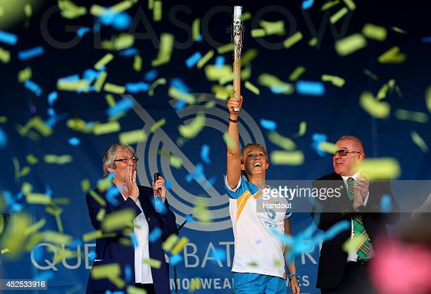 Batonbearer 142 Allison Curbishley holds up the Glasgow 2014 Queen's Baton in Queen's Park on July 22 2014 in Glasgow Scotland Scotland is nation 70...