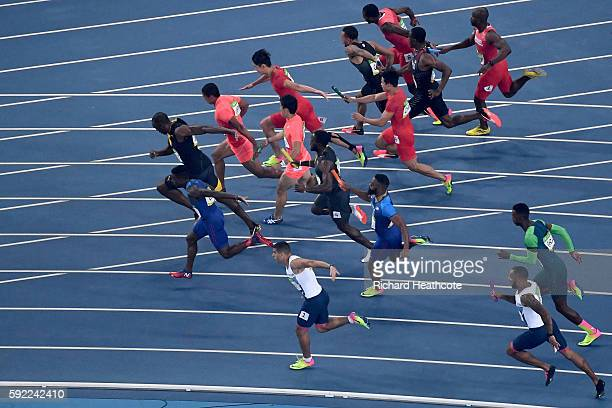 Batons are handed to Usain Bolt of Jamaica Aska Cambridge of Japan Trayvon Bromell of the United States and Andre De Grasse of Canada in the Men's 4...