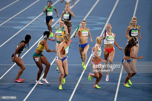 Batons are passed in the first heat of Round One of the Women's 4 x 400m Relay on Day 14 of the Rio 2016 Olympic Games at the Olympic Stadium on...